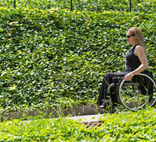 Woman heading down a ramp in a wheelchair
