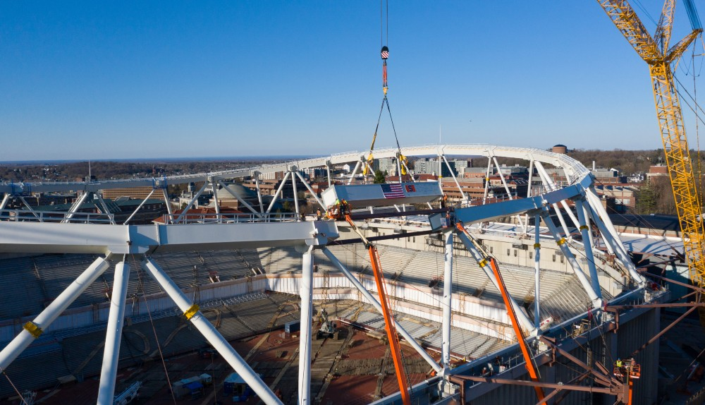 The final beam is placed in crown-truss of stadium replacement roof.